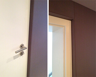 Bord visible recouvert d'un tissu acoustique sur la porte du home-cinéma
