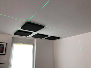 Suunnitellun asettelun siirtäminen kattoon laservesivaa'an avulla